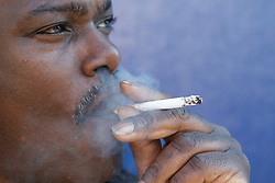 Portrait of black man smoking. Cleared for Mental Health issues.