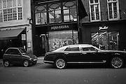 cars parked in Albermarle St. Mayfair, London, ,  7 December 2016
