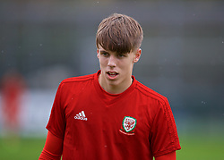 NEWPORT, WALES - Monday, October 14, 2019: Wales' Rhys Hughes during the pre-match warm-up before an Under-19's International Friendly match between Wales and Austria at Dragon Park. (Pic by David Rawcliffe/Propaganda)