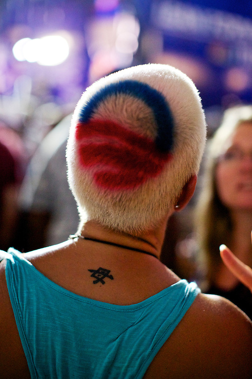 President Barack Obama's logo appears on the head of a supporter in Charlotte, N.C. during the 2012 Democratic National Convention on Sept. 6, 2012.