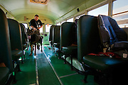 Patrol Officer and K-9 handler Frank Bowne performs a narcotic training exercise through a school bus at Seltice Elementary with Koda, the Post Falls Police Departments two and a half year old German Shepherd K-9 patrol dog on Friday.