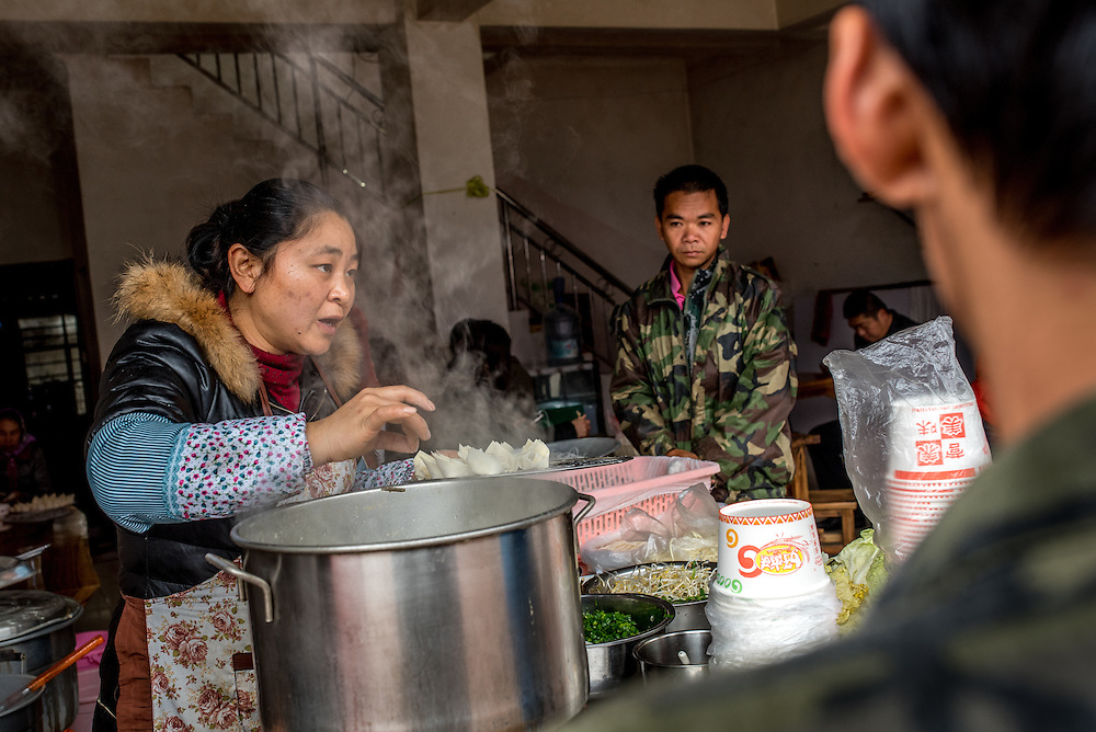 Lunch is served at a small roadside restaurant newar Xishuangbanna, China.