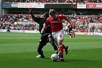 Photo: Pete Lorence.<br />Nottingham Forest v Scunthorpe United. Coca Cola League 1. 07/10/2006.<br />Scunthorpe's Cleveland Taylor and Kris Commons battle for the ball.