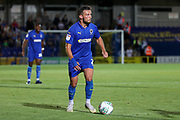 AFC Wimbledon defender Luke O'Neill (2) dribbling during the EFL Cup match between AFC Wimbledon and Milton Keynes Dons at the Cherry Red Records Stadium, Kingston, England on 13 August 2019.
