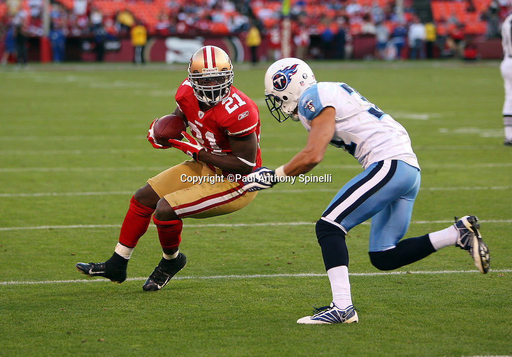 San Francisco 49ers running back Frank Gore (21) tries to elude a tackle attempt by Tennessee Titans cornerback Cortland Finnegan (31) during the NFL football game against the Tennessee Titans, November 8, 2009 in San Francisco, California. The Titans won the game 34-27. (©Paul Anthony Spinelli)