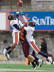 Virginia cornerback Chase Minnifield (13) breaks up a pass intended for Virginia Tech wide receiver Danny Coale (19).  The Virginia Tech Hokies defeated the Virginia Cavaliers 17-14 in NCAA football at Lane Stadium on the campus of Virginia Tech in Blacksburg, VA on November 29, 2008.