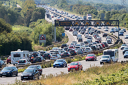© Licensed to London News Pictures. 24/08/2019. Portbury, North Somerset, UK. Bank holiday traffic slows on the southbound M5 motorway on Saturday near to Gordano Services. Photo credit: Simon Chapman/LNP.