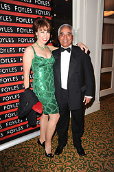 SAM HUSAIN CEO of Foyles and KATHY LETTE  at a gala dinner in celebration of 80 years since the first Foyles Literary Luncheon, held in The Ball Room, Grosvenor House Hotel, Park Lane, London on 21st October 2010.