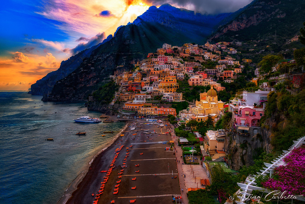 """The mystical evening sunlight peeking through the clouds of Positano""…<br />