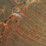 149 of the World's best paragliding pilots from 39 nations descended on the small country town of Manilla near Tamworth in northern New South Wales, Australia to contest the 10th FAI Paragliding World Championships during March 2007. The drought stricken area is renowned for it's great cross country flying from the Mount Borah hillside and over two hectic weeks, numerous incidents and mixed weather, the pilots were able to fly five tasks to decide the winners in what proved to be an extremely close contest.. The Men's competition was won by Great British pilot Bruce Goldsmith with Jean-Marc Caron of France finishing second just seventeen points behind with Thomas Mccune of USA finishing third. The women's competition was won by Petra Slivova of Czech Republic with Viv Williams of Australian just fifteen points behind and New Zealand pilot Harmony Gaw finishing third. .In the team event Czech Republic finished first followed by France and Switzerland...A view looking down from a tandem Paraglider during competition..