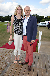 Matt Dawson and Carolin Hauskeller at the Audi Polo Challenge 2013 at Coworth Park Polo Club, Berkshire on 3rd August 2013.