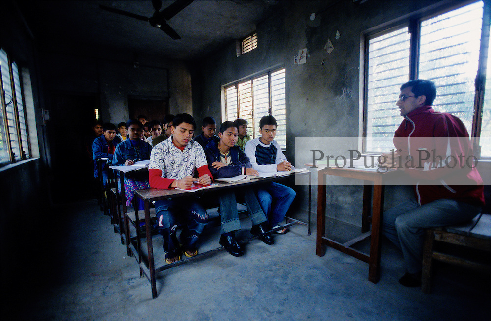 "A classroom in the Mary Golden English School...During the last two days the Maoists have ordered  private and public schools to close down. An Independent Association of Teachers as been set up to deal with the  Maoists threats...""This is a Red Area, we must follow their rules"" a teacher in Kalikot says....."