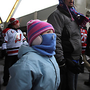 A Young fan dressed to keep warm on a bitterly cold day at Yankee Stadium during the New York Rangers Vs New Jersey Devils NHL regular season game held outdoors at Yankee Stadium, The Bronx, New York, USA. 26th January 2014. Photo Tim Clayton