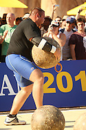 Brian Shaw (USA) negotiates the weight and awkward grip of an Atlas Stones in his head-to-head with defending champion Zydrunas Savickas (Lithuania) during the final rounds of the World's Strongest Man competition held in Sun City, South Africa.