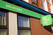 Close up of Job Centre Plus green signs on wall, England, UK