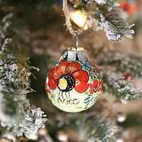 Lauren Wood | Buy at photos.djournal.com<br /> Dustin Shoumaker purchased porcelain Christmas ornaments in Poland while traveling to bring home her three adopted children. Shoumaker and her husband Mitchell arrived home on Dec. 23, 2015 with Gabe, Olivia and Maisy.
