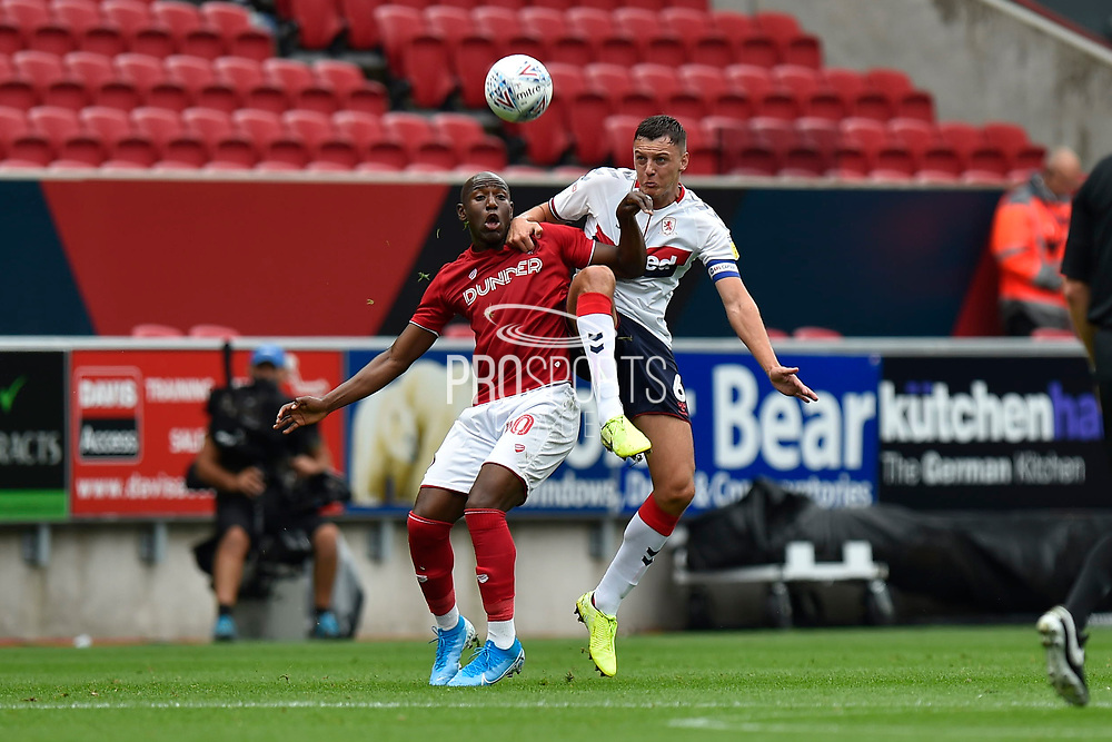 Dael Fry (6) of Middlesbrough battles for possession with Benik Afobe (40) of Bristol City during the EFL Sky Bet Championship match between Bristol City and Middlesbrough at Ashton Gate, Bristol, England on 31 August 2019.