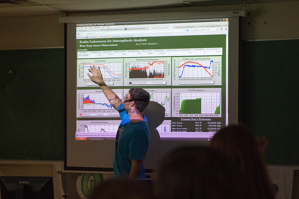 OHIO graduate student Kyle Clem explains data colleced at the West State Street Weather Station to Nelsonville- York fith grade students during a visit to the Scalia Laboratory for Atmospheric Analysis at the Athens Campus. Photo by Ben Siegel