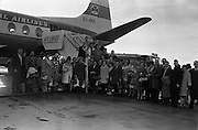 27/01/1963<br /> 01/27/1963<br /> 27 January 1963<br /> Group leave Dublin Airport on Skiing Holiday organised by Joe Walsh Tours. Image shows the group about to board the aircraft.