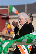 Goshen, New York -  Two women watch the Mid-Hudson St. Patrick's Day parade from the reviewing stand on March 11, 2007.