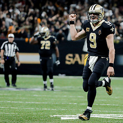 Dec 24, 2017; New Orleans, LA, USA; New Orleans Saints quarterback Drew Brees (9) celebrates after throwing a touchdown to wide receiver Ted Ginn (not pictured) during the second quarter against the Atlanta Falcons at the Mercedes-Benz Superdome. Mandatory Credit: Derick E. Hingle-USA TODAY Sports
