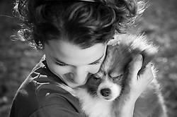 Owner Jacquelyn Jacobs embraces her pet Pomeranian, Princess - Pet Portrait Photography