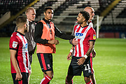 Bruno Miguel Carvalho Andrade of Lincoln City is held back by Lincoln City Caretaker Manager Andy Warrington during the EFL Sky Bet League 1 match between Rochdale and Lincoln City at the Crown Oil Arena, Rochdale, England on 17 September 2019.