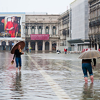 "VENICE - ITALY November 1st 2010 . Tourists walk in St Mark Squre during ""acqua alta"". Venice experiences today ""aqua alta"", or high water, bringing water onto Venice's streets ....***Agreed Fee's Apply To All Image Use***.Marco Secchi /Xianpix. tel +44 (0) 771 7298571. e-mail ms@msecchi.com .www.marcosecchi.com"