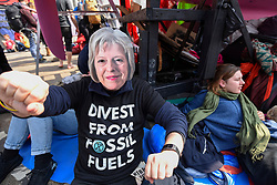 "© Licensed to London News Pictures. 17/04/2019. LONDON, UK.  A protester wears a Theresa May face mask at Oxford Circus during ""London: International Rebellion"", on day three of a protest organised by Extinction Rebellion, demanding that governments take action against climate change.  Marble Arch, Oxford Circus, Piccadilly Circus, Waterloo Bridge and Parliament Square have been blocked by activists in the last three days.  Police have issued a section 14 order requiring protesters to convene at Marble Arch only so that the protest can continue.  Photo credit: Stephen Chung/LNP"
