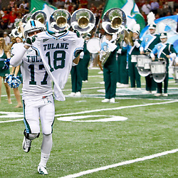 September 22, 2012; New Orleans, LA, USA; Tulane Green Wave cornerback Alex Lauricella (17) holds up the jersey of safety Devon Walker (18) as the team runs on the field before a game against the Ole Miss Rebels at the Mercedes-Benz Superdome. Walker suffered a fractured spine in the collision with a teammate during the first week of the season. Mandatory Credit: Derick E. Hingle-US PRESSWIRE