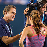 August 25, 2016, New Haven, Connecticut: <br /> Agnieszka Radwanska of Poland is interviewed by tournament emcee Andrew Krasny defeating Kirsten Flipkens during Day 7 of the 2016 Connecticut Open at the Yale University Tennis Center on Thursday, August  25, 2016 in New Haven, Connecticut. <br /> (Photo by Billie Weiss/Connecticut Open)