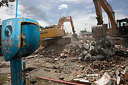 Padang, Western Sumatra, Indonesia, 7th October 2009:?Heavy machinery works to remove the remains of an earthquake affected building in Padang following a devastating earthquake in Western Sumatra that claimed the lives of an estimated 2000 people.?Photo: Joseph Feil