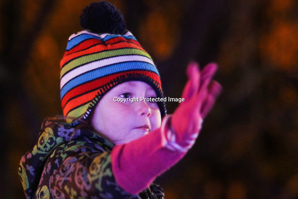 Brianna Petrone, 3, waves to floats during the 12th Annual Wilmington Holiday Parade Sunday December 7, 2014 in Wilmington, N.C. (Jason A. Frizzelle)
