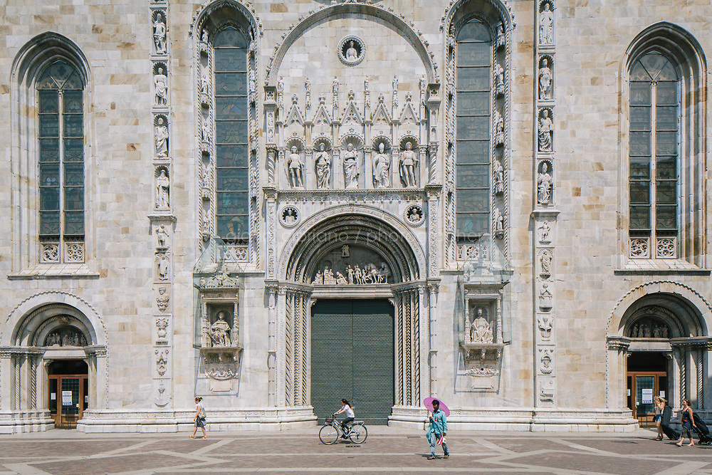 COMO, ITALY - 21 JUNE 2017: A view of the Cathedral of Como, Italy, on June 21st 2017.<br /> <br /> Residents of Como are worried that funds redirected to migrants deprived the town&rsquo;s handicapped of services and complained that any protest prompted accusations of racism.<br /> <br /> Throughout Italy, run-off mayoral elections on Sunday will be considered bellwethers for upcoming national elections and immigration has again emerged as a burning issue.<br /> <br /> Italy has registered more than 70,000 migrants this year, 27 percent more than it did by this time in 2016, when a record 181,000 migrants arrived. Waves of migrants continue to make the perilous, and often fatal, crossing to southern Italy from Africa, South Asia and the Middle East, seeing Italy as the gateway to Europe.<br /> <br /> While migrants spoke of their appreciation of Italy&rsquo;s humanitarian efforts to save them from the Mediterranean Sea, they also expressed exhaustion with the country&rsquo;s intricate web of permits and papers and European rules that required them to stay in the country that first documented them.