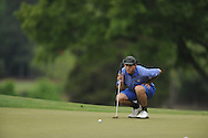 Oxford High's Ethan Holmes putts on the 15th hole during the closing round of the MHSAA Class 5A state championship golf tournament at the Ole Miss Golf Course in Oxford, Miss. on Thursday, May 2, 2013. Oxford High won to win the state championship.