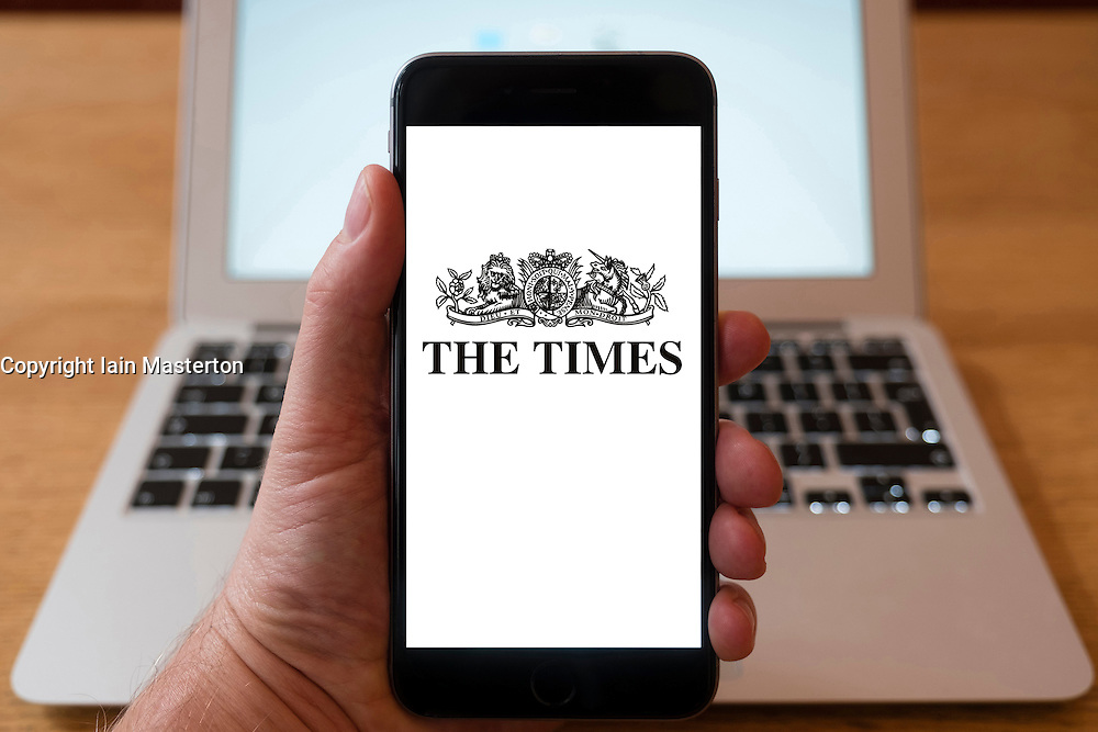 Using iPhone smartphone to display logo of The Times newspaper