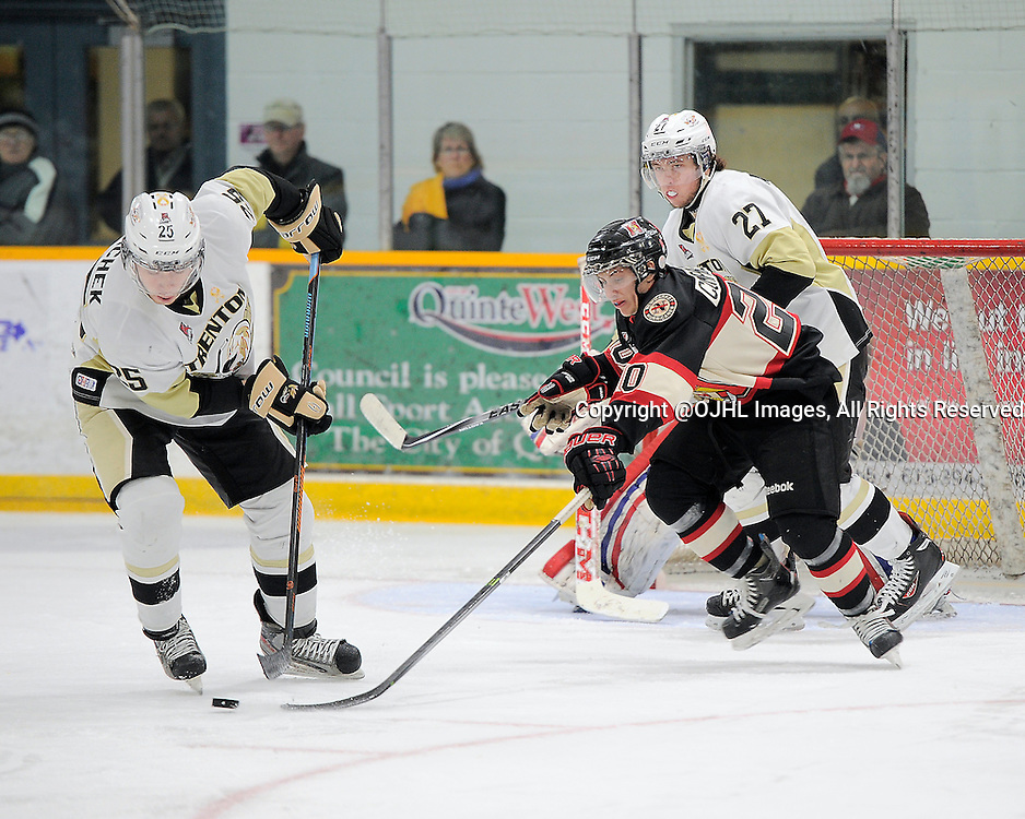 TRENTON, ON - Jan 30, 2015 : Ontario Junior Hockey League game action between Newmarket and Trenton, Bobby Polachek #25 of the Trenton Golden Hawks and Aidan Comparelli #20 of the Newmarket Hurricanes battle for the puck<br /> (Photo by Amy Deroche/ OJHL Images)