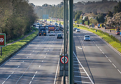 © Licensed to London News Pictures. 23/03/2020. London, UK. At 08:32 am traffic on the A3 at Kingston Vale in south west London, which is normally busy with commuters heading in to town, looked much quieter this morning as many Londoners decide to work from home or self-isolate to help in the battle against the spread of the coronavirus disease. Photo credit: Alex Lentati/LNP