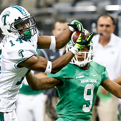 Oct 5, 2013; New Orleans, LA, USA; Tulane Green Wave cornerback Jordan Batiste (14) defends a pass against North Texas Mean Green wide receiver Brandon Johnson (9) during the second half at Mercedes-Benz Superdome. Mandatory Credit: Derick E. Hingle-USA TODAY Sports