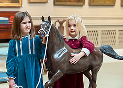 Sisters Clementine (4) and Eloise (6) from Edinburgh with a bronze of the Arabian Stallion Twaig, expected to fetch in excess of £10,000 when it goes under the hammer at Bonhams sporting auction in Edinburgh this week.<br /> <br /> © Dave Johnston/ EEm