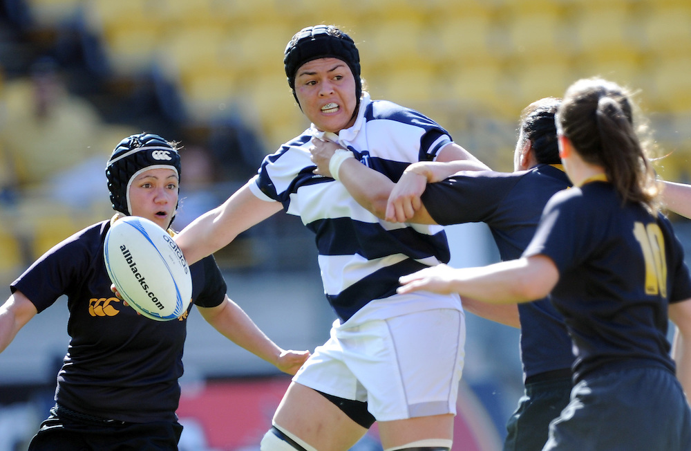 Auckland's Eloise Blackwell offloads against Wewllington in the Provincial Women's Championship rugby match, Westpac Stadium, Wellington, New Zealand, Saturday, September 29, 2012. Credit:SNPA / Ross Setford