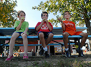 From left Grace Young, 6, Thomas Clark, 8, and Jake Young, 8, eat apples at Pioneer Orchard in Jackson, Mo., on Saturday, Oct. 9, 2010. The Orchard offers a variety of fall activities for visitors, including hay bale rides, corn and hay bale mazes, and pumpkins and apples for purchase.