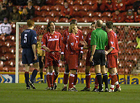 Photo. Glyn Thomas.<br /> Middlesbrough v Portsmouth. FA Barclaycard Premiership.<br /> Riverside Stadium, Middlesbrough. 06/12/2003.<br /> Boro players remonstrate with the ref after Jonathan Greening is given a yellow card.