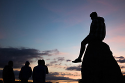 © Licensed to London News Pictures. <br /> 20/06/2014. <br /> <br /> Castlerigg Stone circle, Cumbria, England<br /> <br /> Visitors to the ancient site of Castlerigg Stone Circle near Keswick in Cumbria watch the sunset on the evening of the Summer Solstice.<br /> <br /> Photo credit : Ian Forsyth/LNP