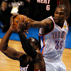 Jun 14, 2012; Oklahoma City, OK, USA;  Oklahoma City Thunder small forward Kevin Durant (35) tries to block the shot of Miami Heat shooting guard Dwyane Wade (3) during the first quarter of game two in the 2012 NBA Finals at Chesapeake Energy Arena. Mandatory Credit: Derick E. Hingle-US PRESSWIRE