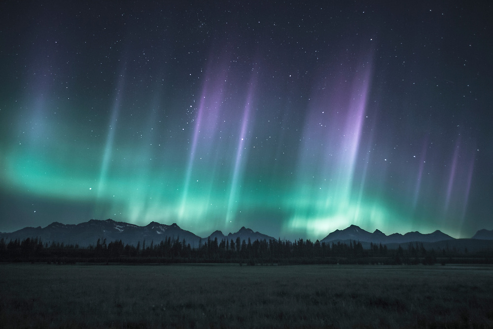 A summer aurora over the west side of Glacier Nat'l Park, near Polebridge Montana. A kp 7 event.