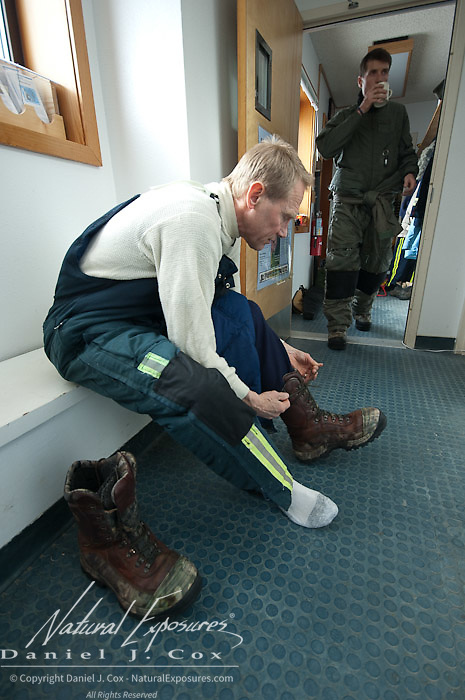 Steve Amstrup, lead USGS polar bear biologist prepares for a day of field work in Kaktovik, Alaska.