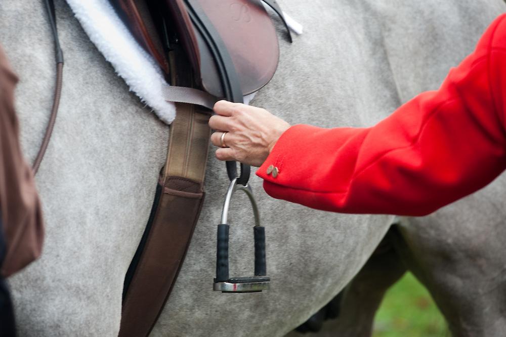 Jockey mounting horse