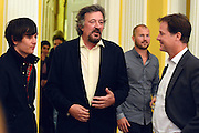 © Licensed to London News Pictures. 11/09/2013. London, UK Stephen Fry (centre) talks to Nick Clegg (right). The Deputy Prime Minister, Nick Clegg, hosts a reception at Admiralty House in Whitehall this evening, 11 September 2013, to celebrate the government's progress in equal marriage. From next year gay people will be able to get married. A number of high profile guests including openly supportive celebrities, campaigners, religious figures and charities were in attendance.<br /> The London Gay Men Chorus Ensemble performed at the event. . Photo credit : Stephen Simpson/LNP