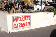 Sign advertising waterless car wash, Fish Hoek, Cape Town.